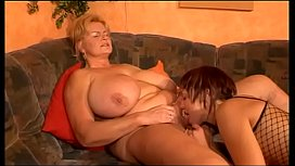Mature woman with incredible huge tits fucked by y. girl