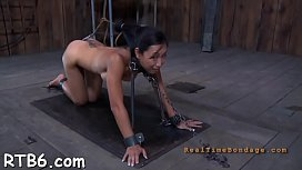 Demure slaves are clamped up for severe castigation