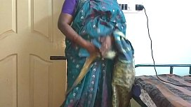 desi indian tamil telugu kannada malayalam hindi horny cheating wife vanitha wearing blue colour saree showing big boobs and shaved pussy press hard boobs press nip rubbing pussy masturbation