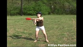 Cute teen Kitty playing baseball outdoors