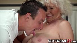 Short hair grandma teases with big tits before banging