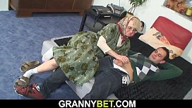 Hot four-eyed grandma spreads legs for him