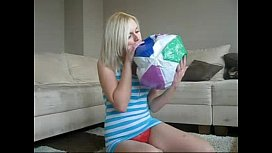Sophie in miniskirt smokes then plays with her body