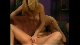 Hot lesbian lays on the sofa and gets fucked with a dildo by girl