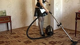 A maid vacuum cleaner and masturbates her ass