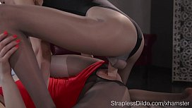 Slender Girl in Pa ose and Leotard Fucks her GF with Strapon