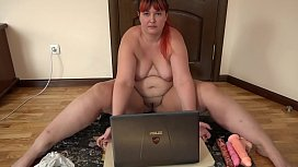 A fat girl is engaged in virtual sex on Skype