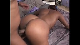 Fat ass ebony bitch Teddi Bear gets her cunt slammed with a black dong in bed