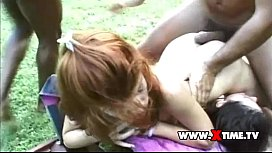 A redhead girl banged by a big black cock