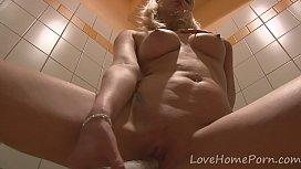 Blonde hottie loves to masturbate in the bathroom