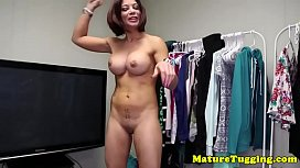 Busty MILF wanking and stroking oiledup cock