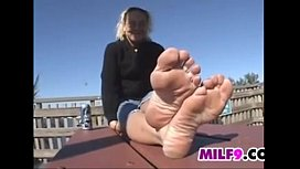 Mature Woman Teases Her Feet Outside
