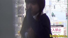 Japanese teen in uniform fingers her pussy