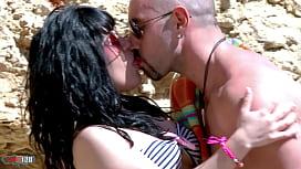 Two spanish sluts taste cock at the beach