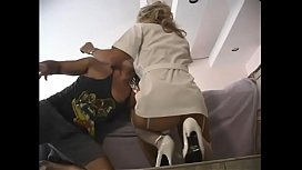 Busty blonde nurse in white nurses outfit