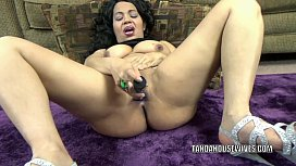 Chubby housewife Dolly Naught is playing with a dildo