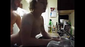 fucking slut in the ass doing dishes.