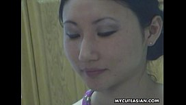 Tied up Asian lass with small boobies endures the session
