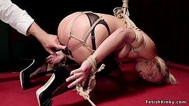 Blonde in stockings toyed in bondage