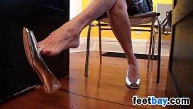 Mature Woman Dangling Her High Heels