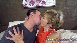 Buxom grandma blows cock