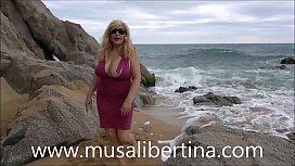 Public masturbation in nudist beach by Musa Libertina