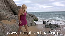 Public masturbation in nudist beach by Musa Libertina