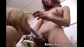 Busty Kira and Holly playing with dildo