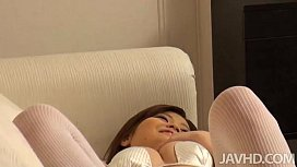 Sweet idol Nao in white satin and white leggings with lace lies on the couch pla