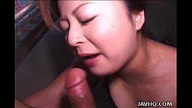 Busty Japanese woman receives a big throbbing boner