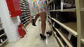 A voyeur with a hidden camera in a public place watches juicy booty. Foot fetish and peeping under a skirt in a shoe store.