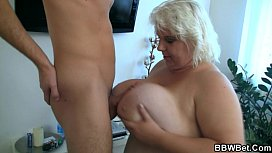 Huge blonde gives a titjob