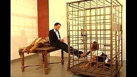 German secretary girl licks feet and sucks cock of her boss in cage