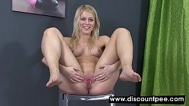 Soaking wet blonde toys herself with dildo