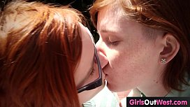 Hairy lesbian redheads fuck outdoors