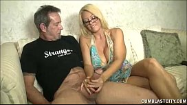 Hugetitted milf enjoys jerking cocks