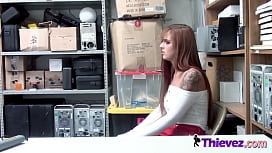 Super hot red hair hottie gets nailed against the desk in the guard office