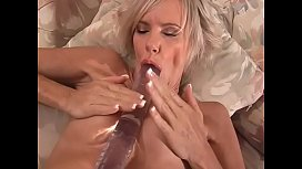 Lecherous latinum blonde cougar with big boobs Cara Lott likes to bang her cunt with fingers and massive toy turn and turn about