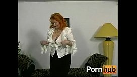 Redheaded German granny shows off for the camera Pornhubcom