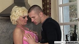 Blonde mature and the snow worker