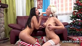 Sweet lesbian teenies get covered with piss and splatter wet muffs