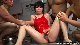 Covered in wam oil and she gets gang fucked