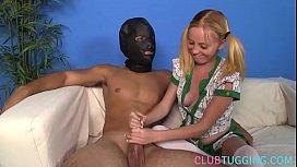 Young beauty gives handjob to a masked man