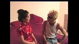 Asian slut Suzi Suzuki has interracial sex with white stud on the bed