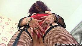 British granny Zadi'_s old fanny still enjoys a dildo filling