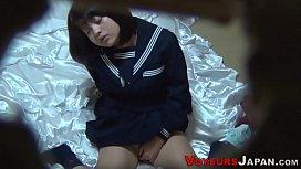 Uniformed asian babe rubs