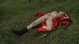 On the grass masturbating