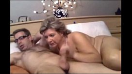 Hot milf is sucking a young stud in front of the camera showing off his hard dick sexycamshowcom
