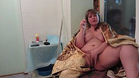 Completely naked bbw smokes a cigarette and masturbates a hairy pussy, a compilation of amateur video.