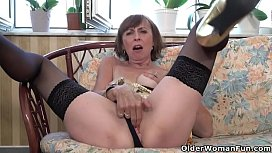 Sexy granny Danina pleases her pussy in front of window